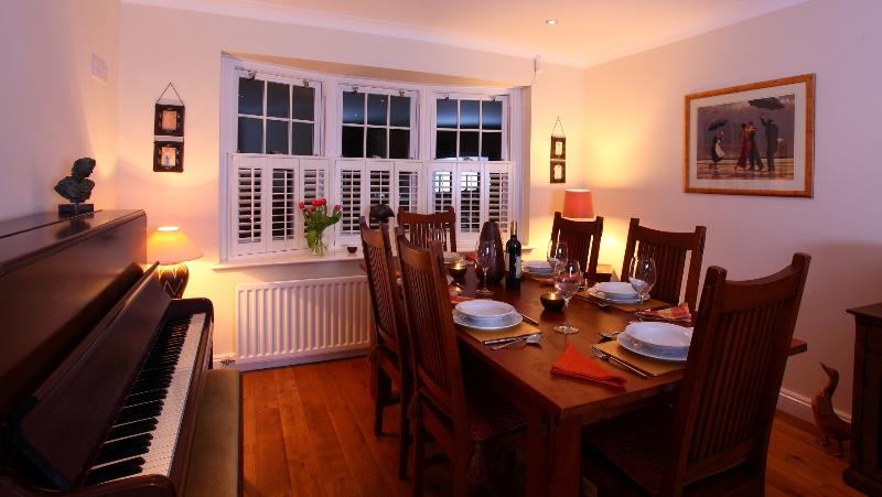 Dining area - ideal for nights in and a piano for those that play!