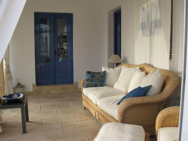 The sun room leading to the Mediterranean bedroom