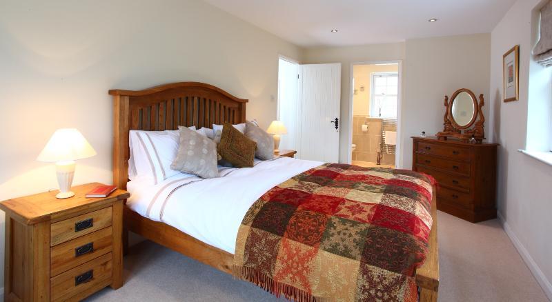 Master bedroom with queen size bed, en-suite bathroom and separate dressing room