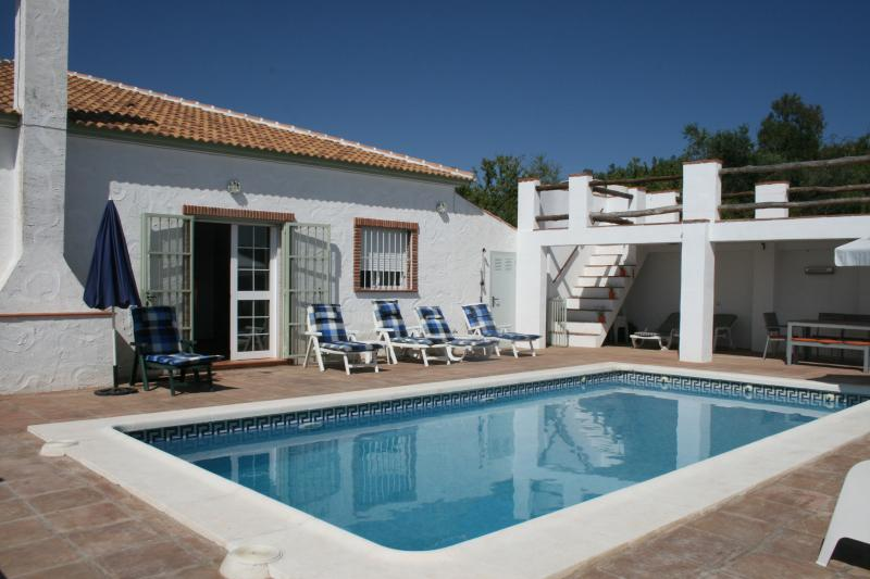 The pool with place for sunchairs, and under the terras a place in the shade.