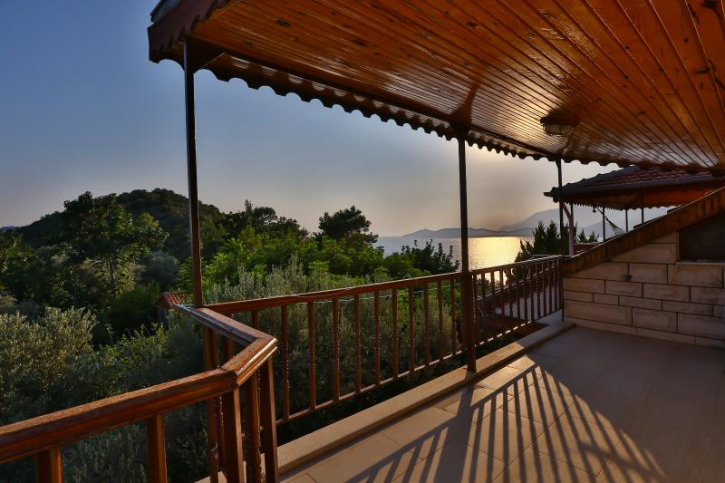 Double bedrooms private balcony with sea and mountain view.