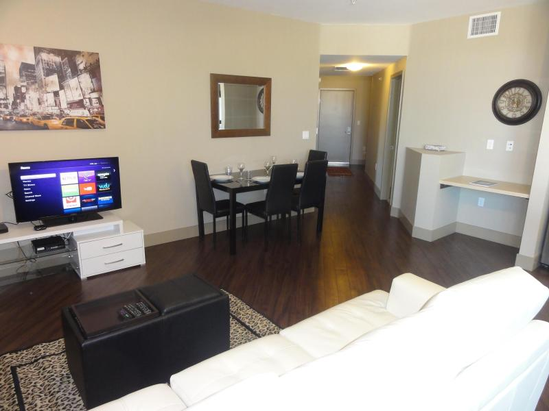 spacious living room with Smart TV and high speed internet