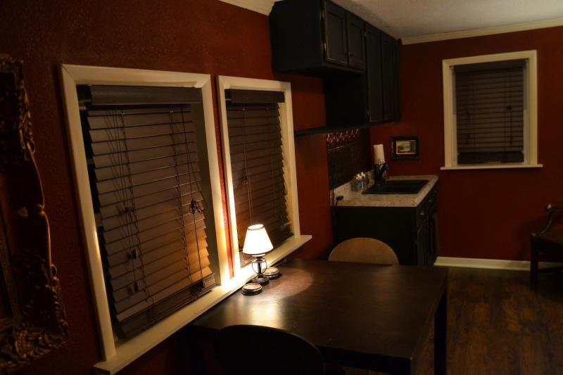 Main living room with dining room table. (Fridge & other appliances shown in next photo)
