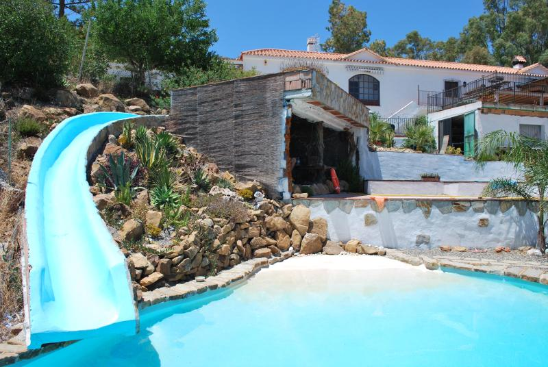 Stunning pool...'beach' area, slide and 'cave' where you can keep cool whilst su