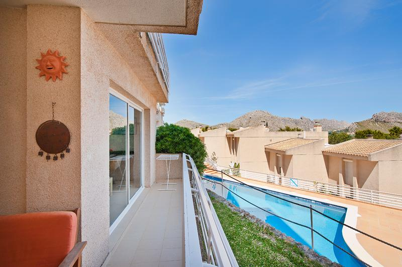 Terrace overlooking gardens and pool, with sea and mountains views