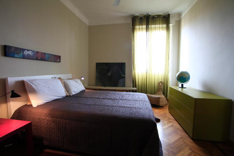 the sleeping room with queen size bed and ceiling fan
