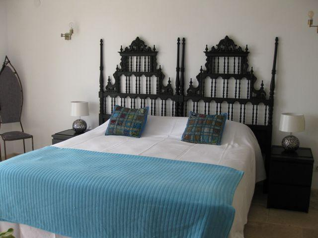 Mediterrranean bedroom with direct access to sunroom and pool area, early morning swim!