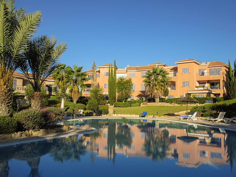 View across the pool to the Limnaria Villas apartments