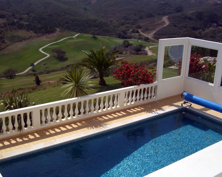 View from the villa over the private pool and golf course