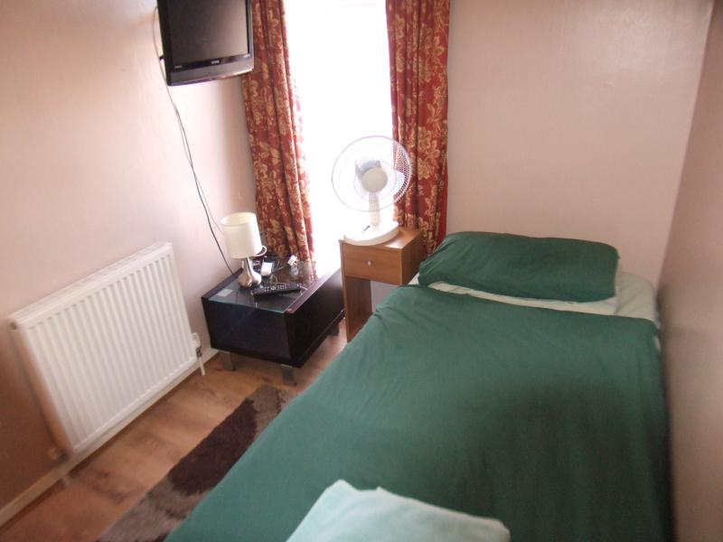 single bed sleep one, have got television, a wadroob side table and lamp.