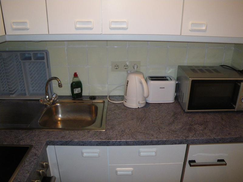Newly refurbished fully equipped kitchen with oven , hob, microwave, fridge and all cooking utensils