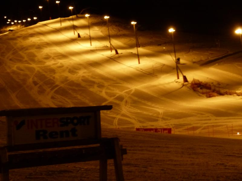 Floodlit ski slope in centre of village for late night skiing and location for weekly floodlitski sh