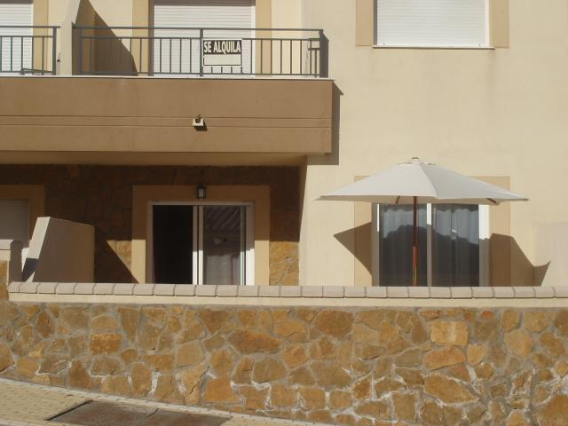 View of our ground floor apartment from the road. You have parking on road or in a secure car park.