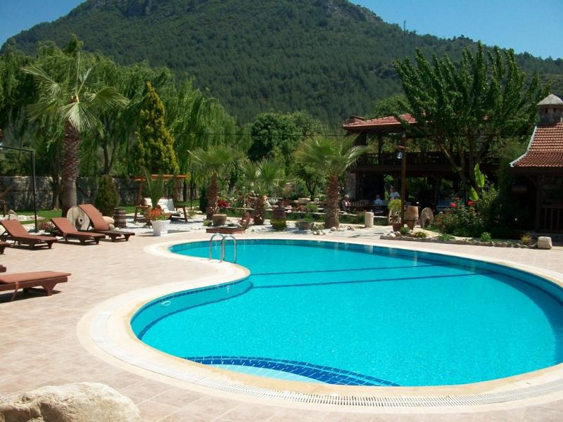 Pool view with stunning lush moutain back drop.