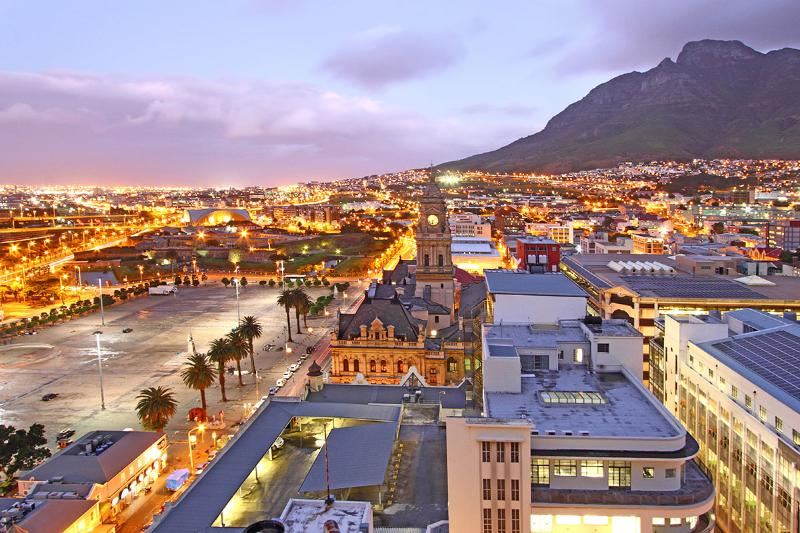 Views across the city's historic buildings to Table Mountain from this apartment