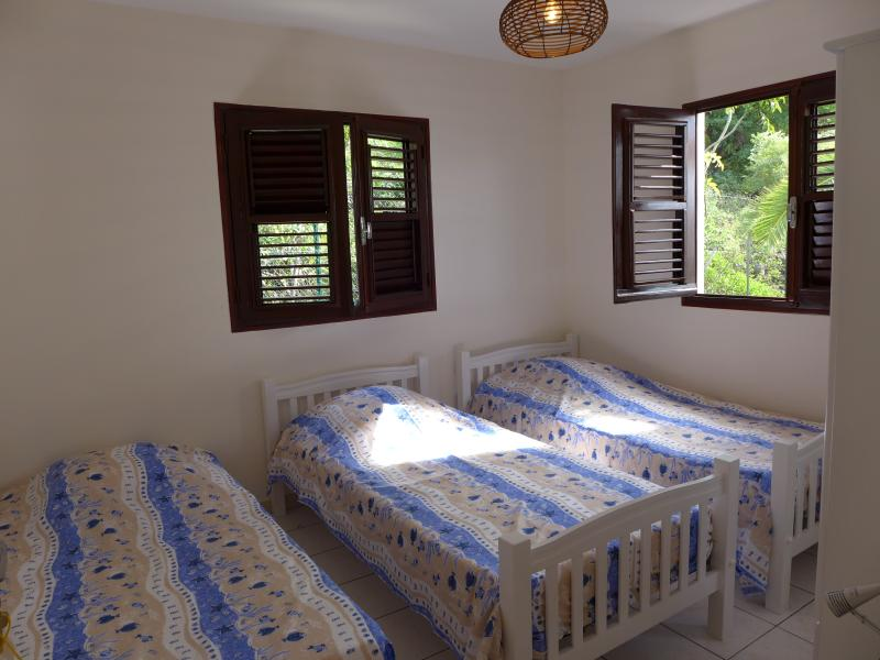 Villa Rose Phoenix - Bedroom 1 with its ventilantes leaf windows and air conditioning.