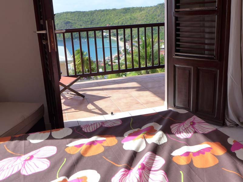 the same sea view room with another bed cover, mosquito net and air conditioning. safe .