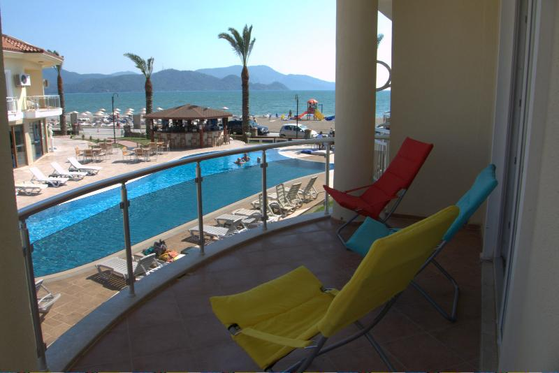 Relax on the balcony overlooking the pool, the beach and warm Mediterranean sea
