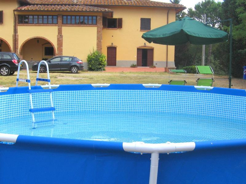 Swimming pool and property in the background