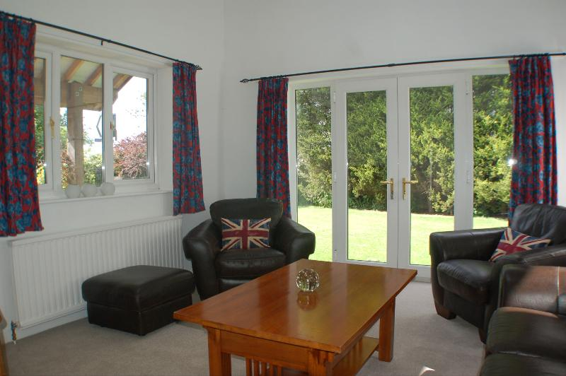 Sitting room with french windows to the garden