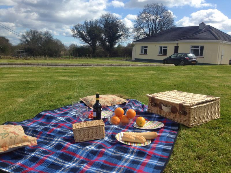 Picnic time on the front lawn at Primrose Cottage with views of fields and gently sloping hills
