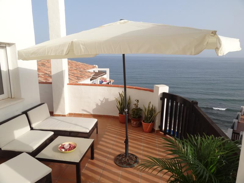 Terrace with breathtaking views over the sea, beach and pools