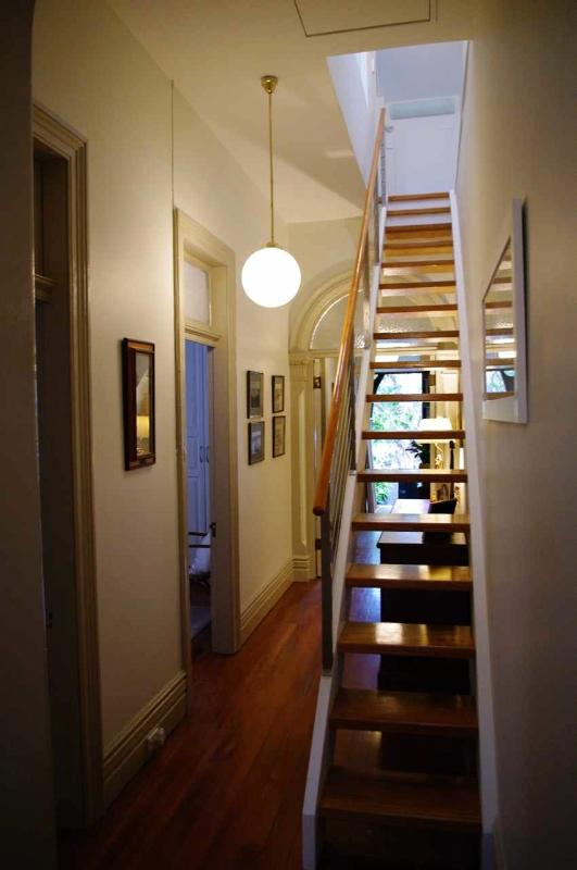 Hallway with stairs to upstairs bedroom and en-suite.
