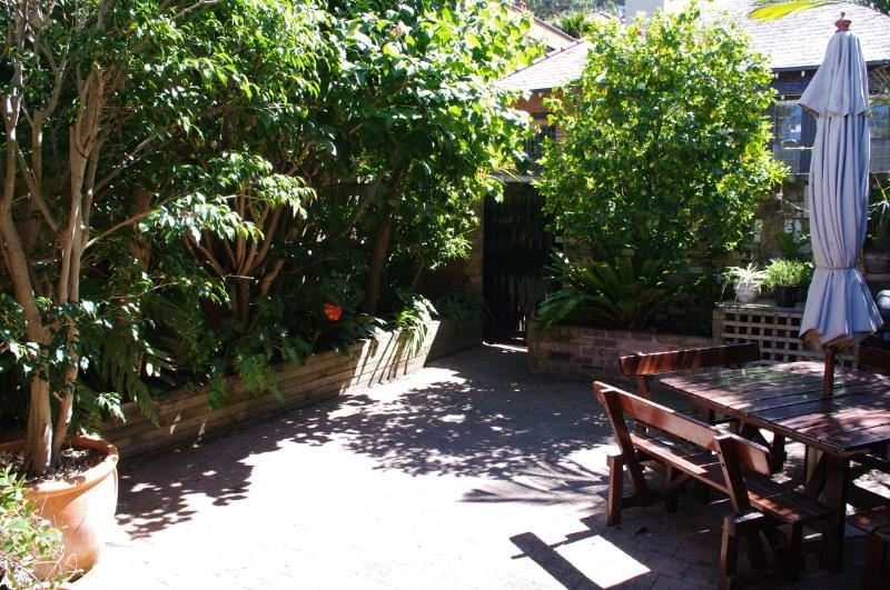 Sunny Courtyard with outdoor setting and BBQ