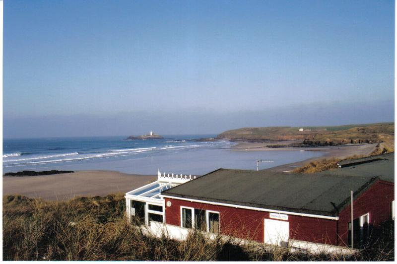 Surfside Chalet - nestled in the sand dunes overlooking Gwithian Beach and Godrevy lighthouse.