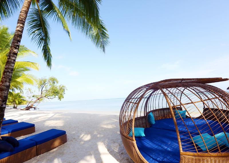 Relax outside the Tiki Bar in Private Lounges