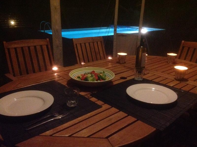 Romantic evening meal by the pool