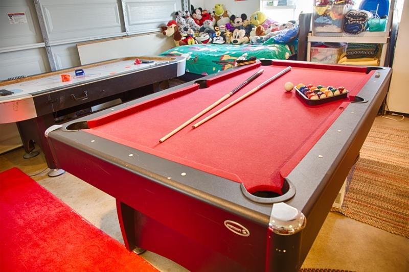 Pool table, air hockey, foozeball and ping pong in the garage.