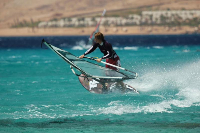Windsurfing in the stunning turquoise water in 'speedy'