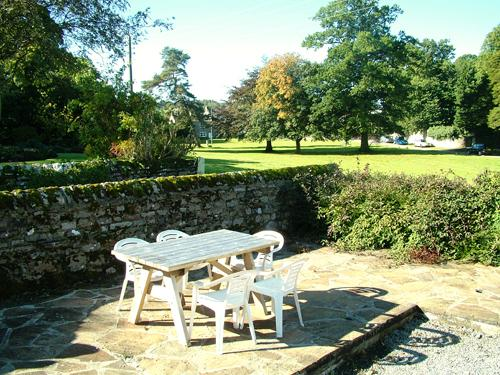 The cottages private patio on the edge of the village green