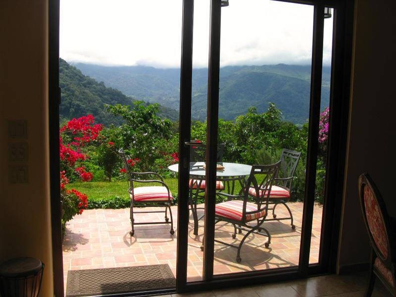 Sliding glass doors open to the terrace
