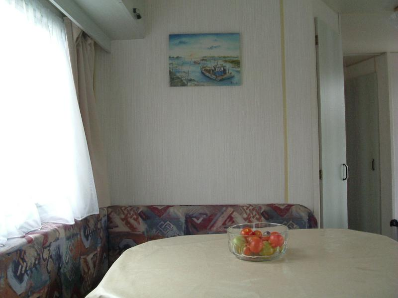 Dining area.with arch to living space. Seating converts to double bed. Overhead lockers.