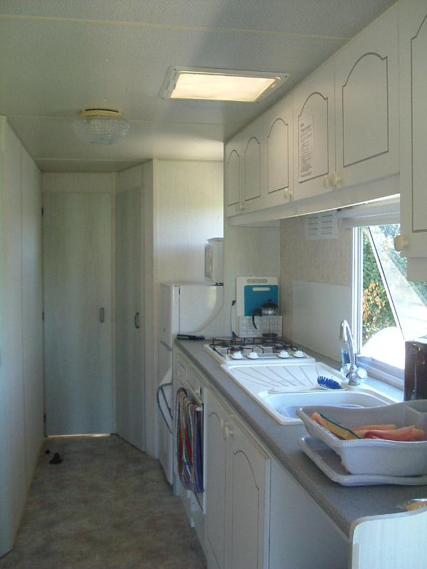 Galley kitchen. Four ring gas cooker with oven. Microwave, fridge freezer. Fully equipped  for all.