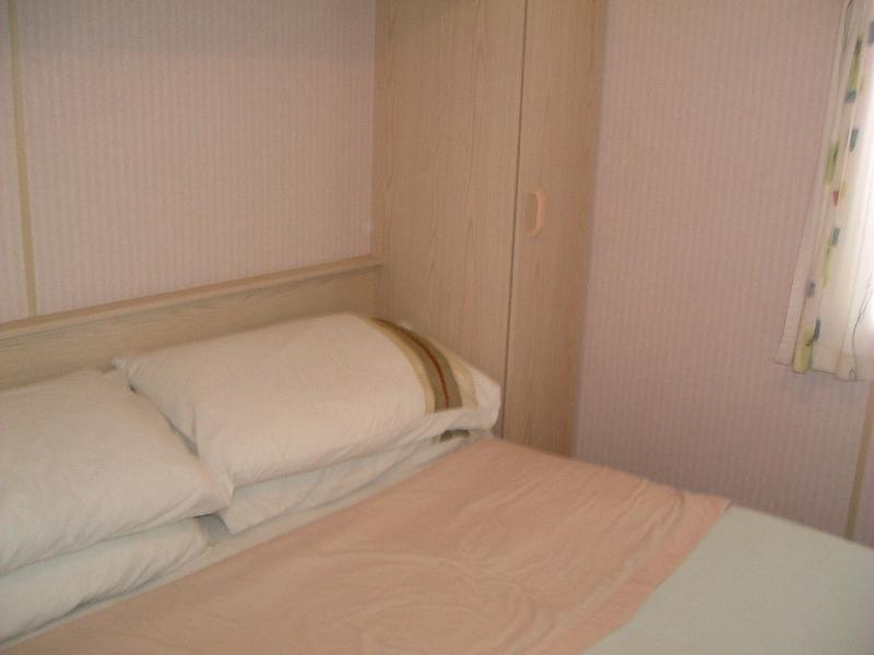 Main bedroom. Double bed, pillows & blankets supplied. 2 wardrobes, further cupboards & powe