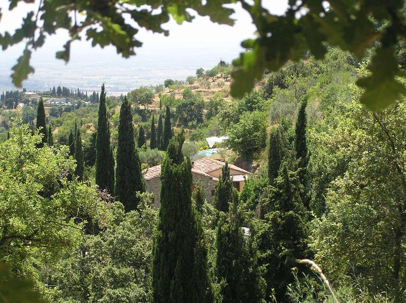 Nestled into the hillside with expansive views over the Cortona valley to Lake Trasimeno.