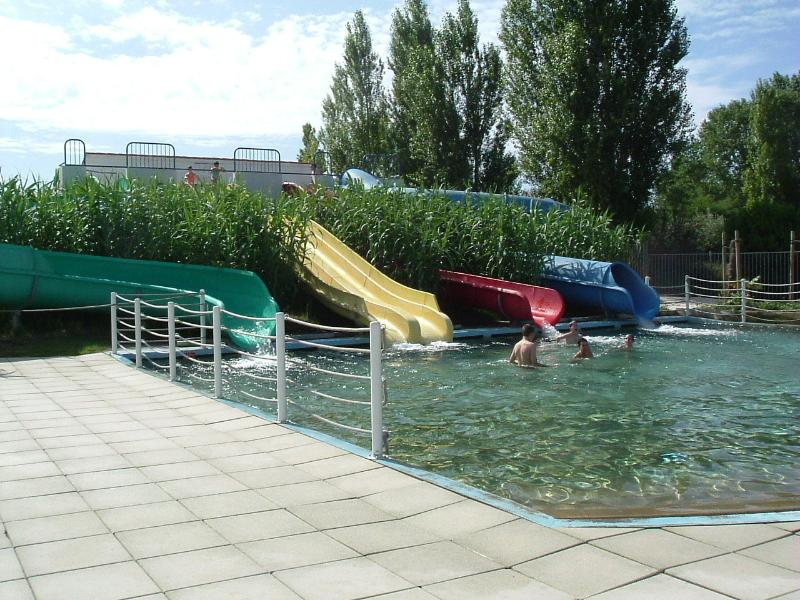 Water slide pool with a variety of flumes and wide lounger area.