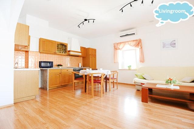 spacious living room with kitchen and dining area