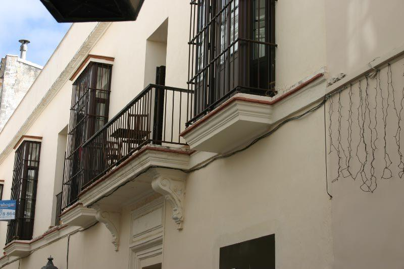 Outside of the building showing the apartments two balconies