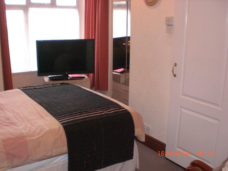 Lounge/bedroom with right hand sliding door leading to shower room etc.