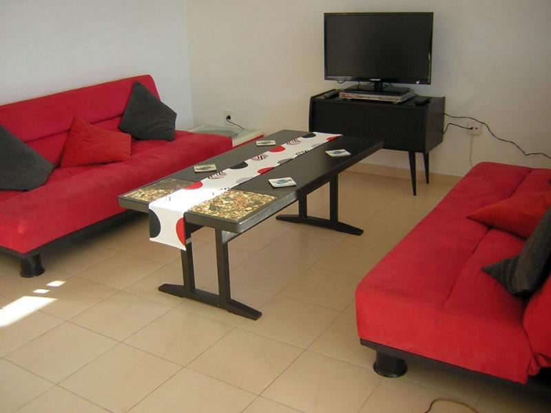 Bright, colourful lounge, with seating for 6, 32' TV, DVD/CD player, books and magazines.