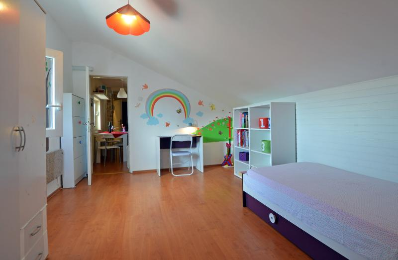 Single bedroom with a rainbow detail