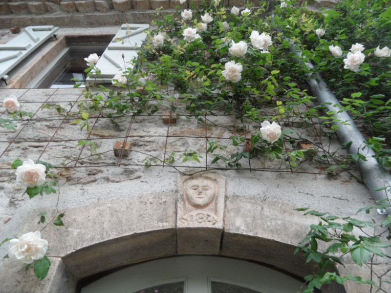 Stone carving and date above the front door