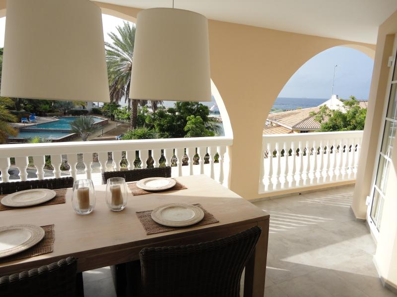 Spacious porch with dining table and room for 4 guests and of course, a stunning view!