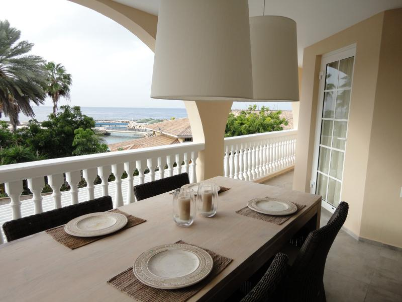 Dining while enjoying the stunning view and fresh breeze from the caribbean sea!