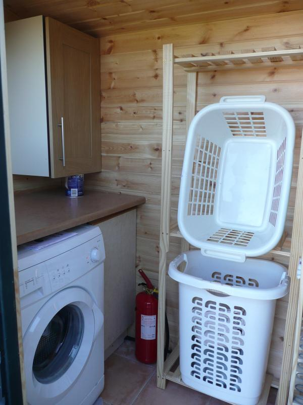 Utility area complete with a washing machine, Ironing board, Tourist information leaflets.