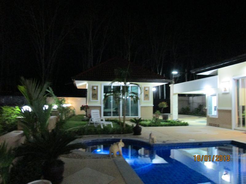NIGHT VEIW OF POOL HOUSE.POOL AND JUCUZZI